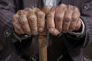 40896284-hand-of-a-old-man-holding-a-cane